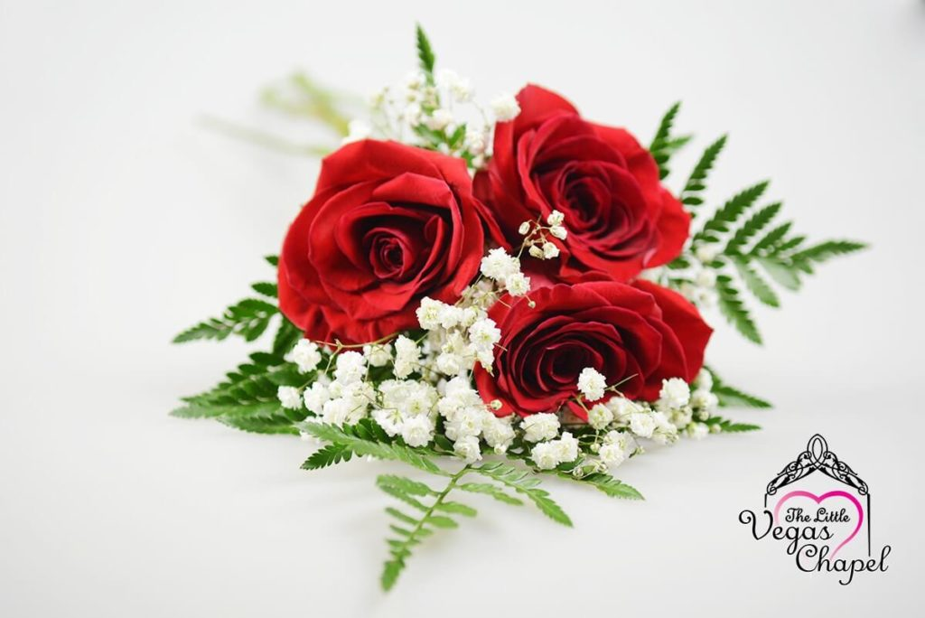 Three Stem Hand Tied Bouquet With Red Roses