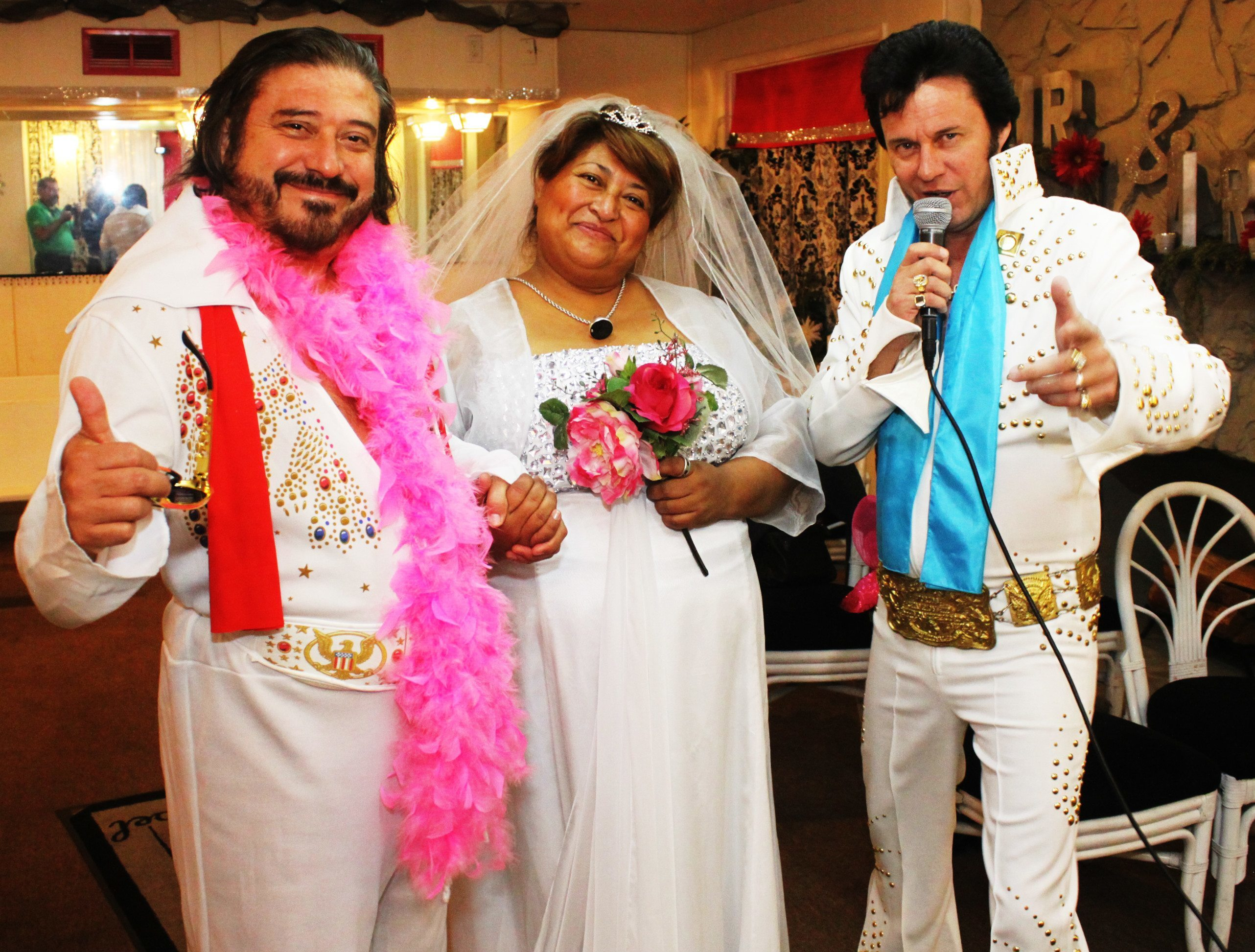 groom and bride dress up for their wedding day with Elvis as their minister