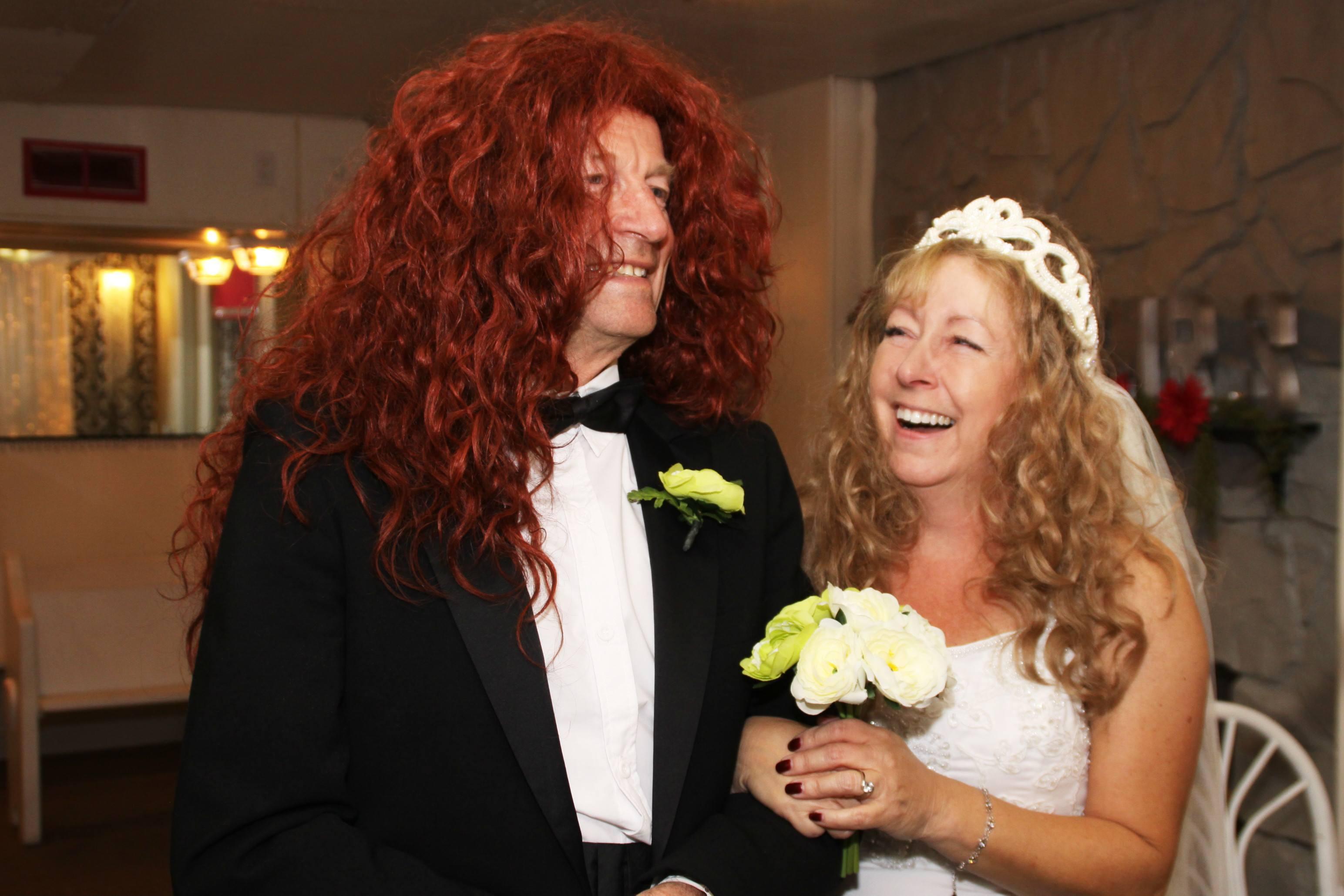 bride and groom, both wearing wigs.