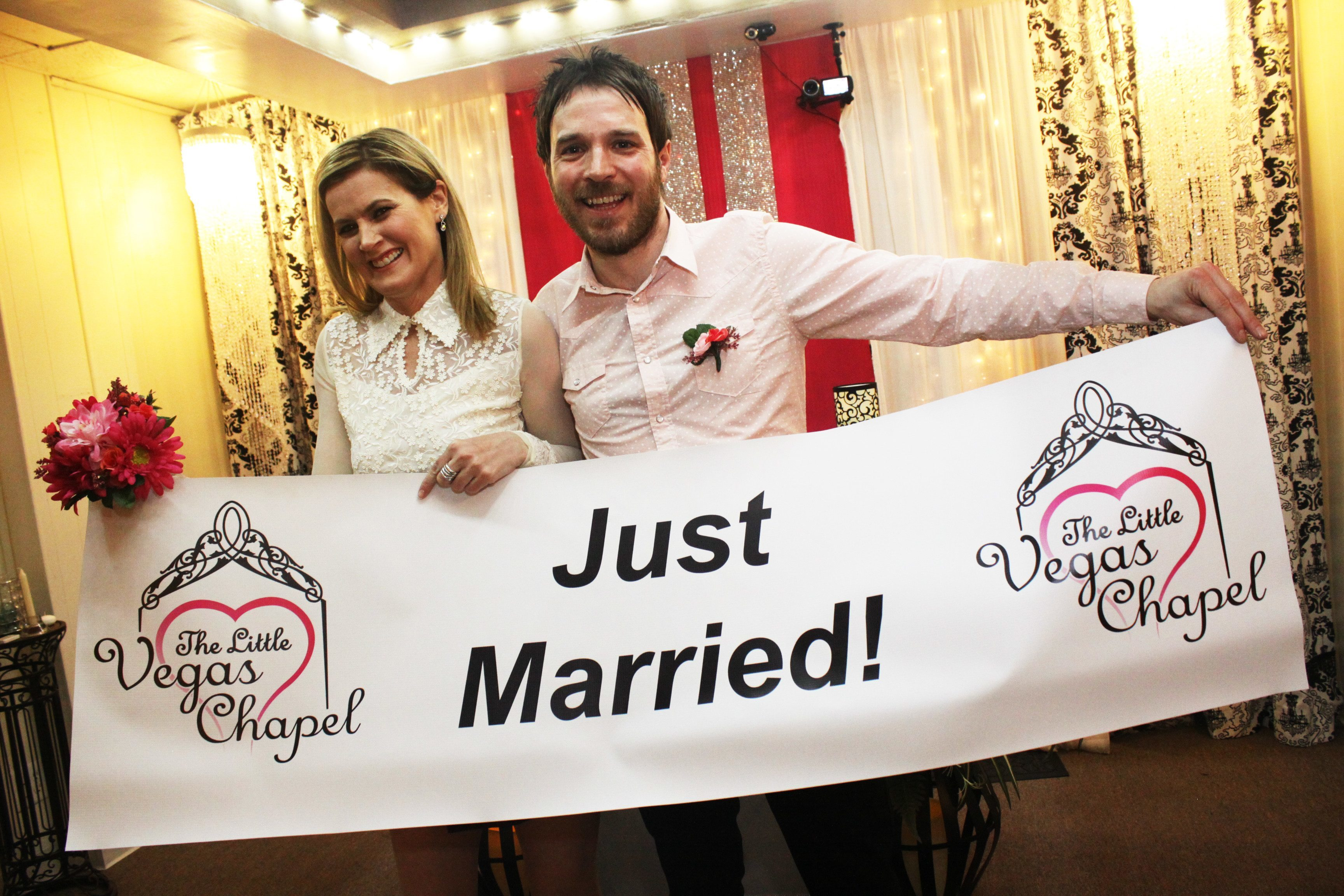 Couple holds up just married sign