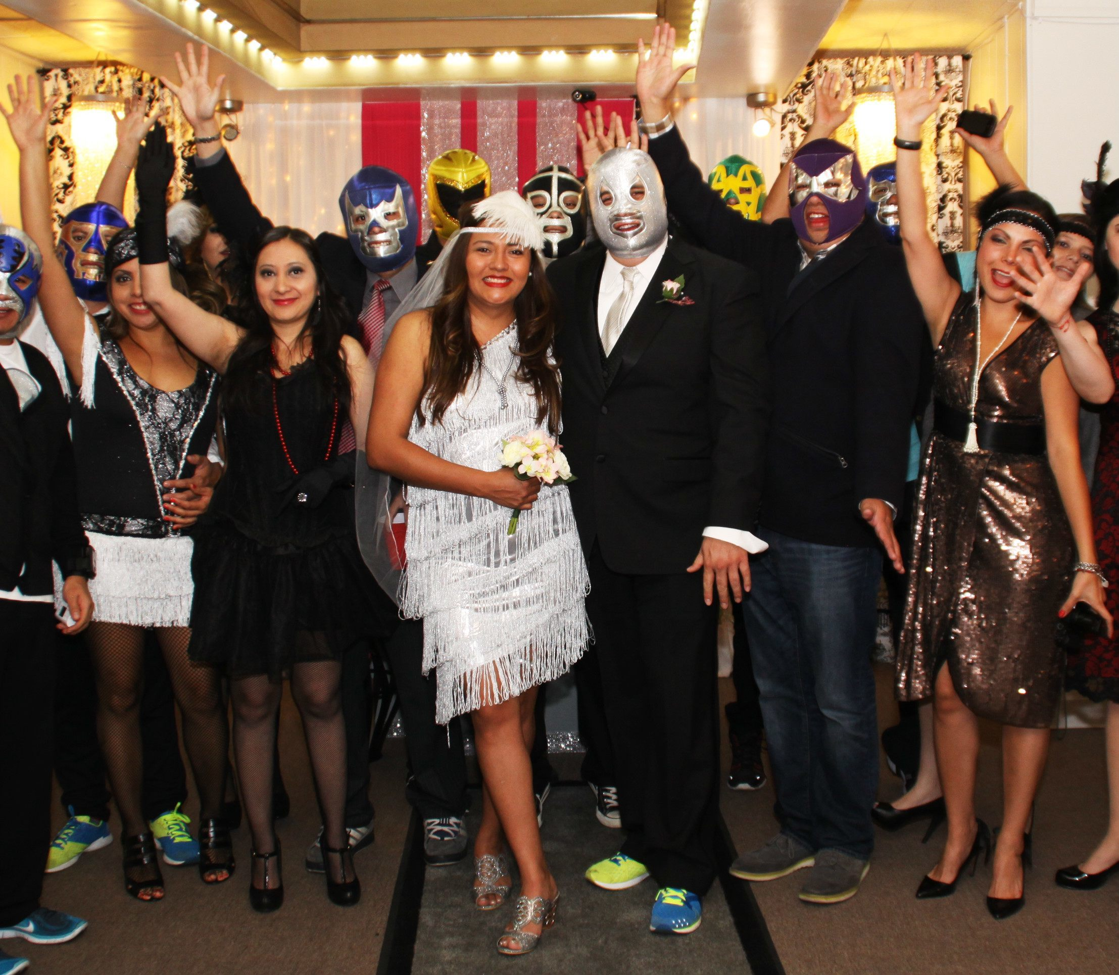 men wear wrestling masks, women wear flapper dresses at themed wedding.