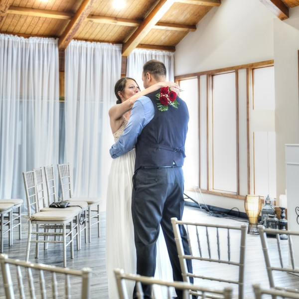 Wedding couple dancing inside chapel
