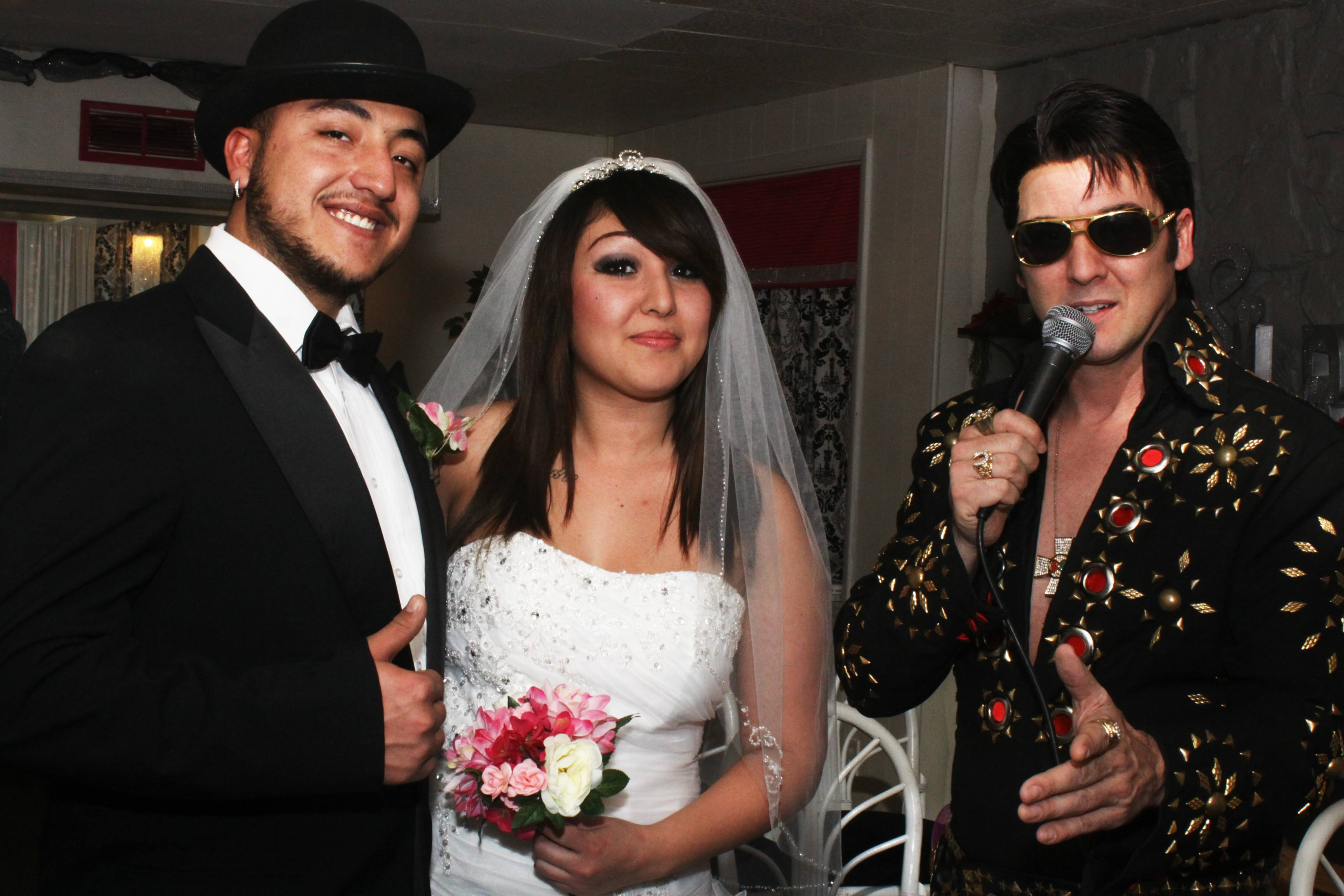 Bride and groom with Elvis inside chapel