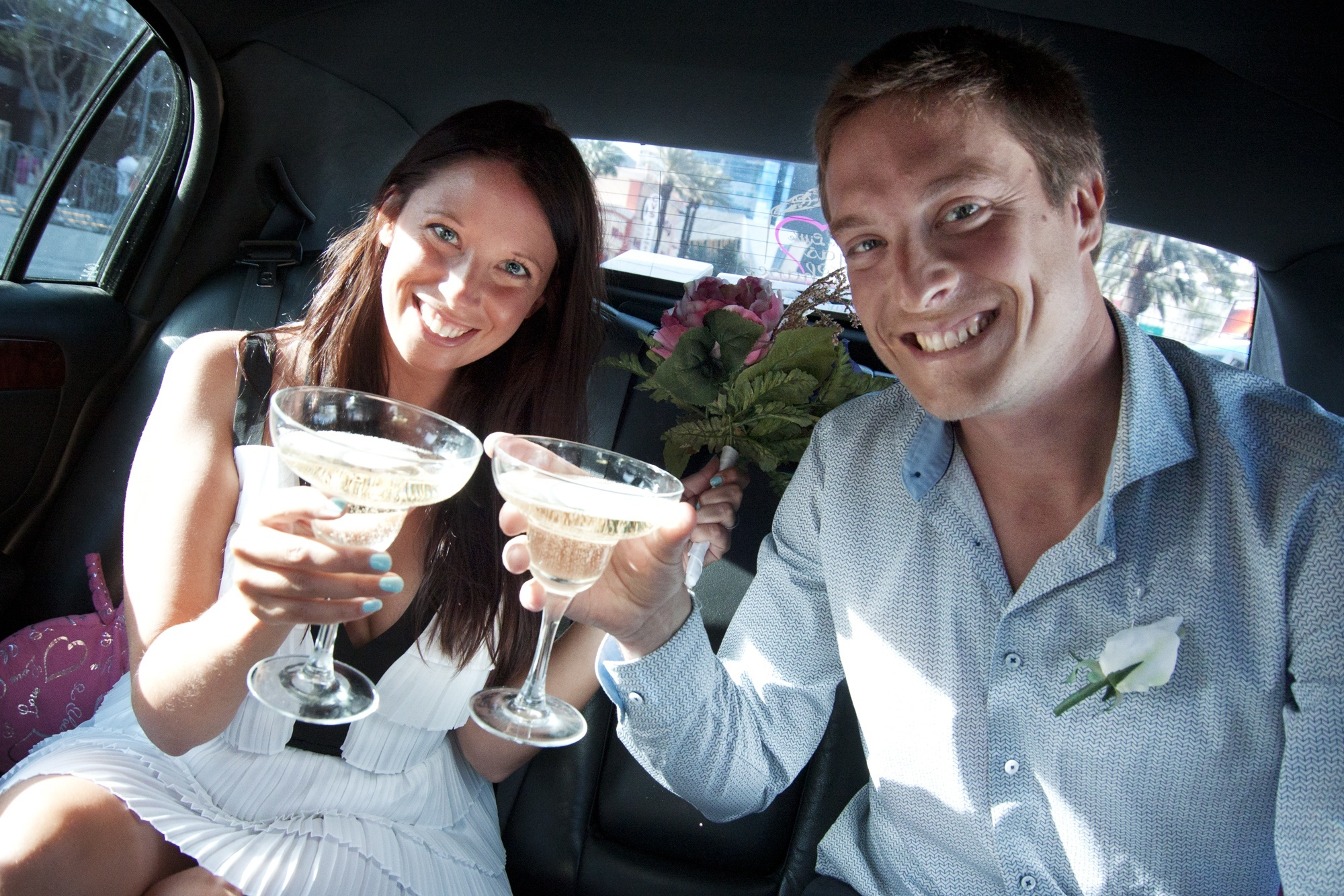 This French couple toasts in our limo after just getting married by the Little Vegas Chapel!