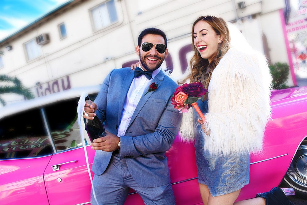 Couple in front of Las Vegas pink Cadillac