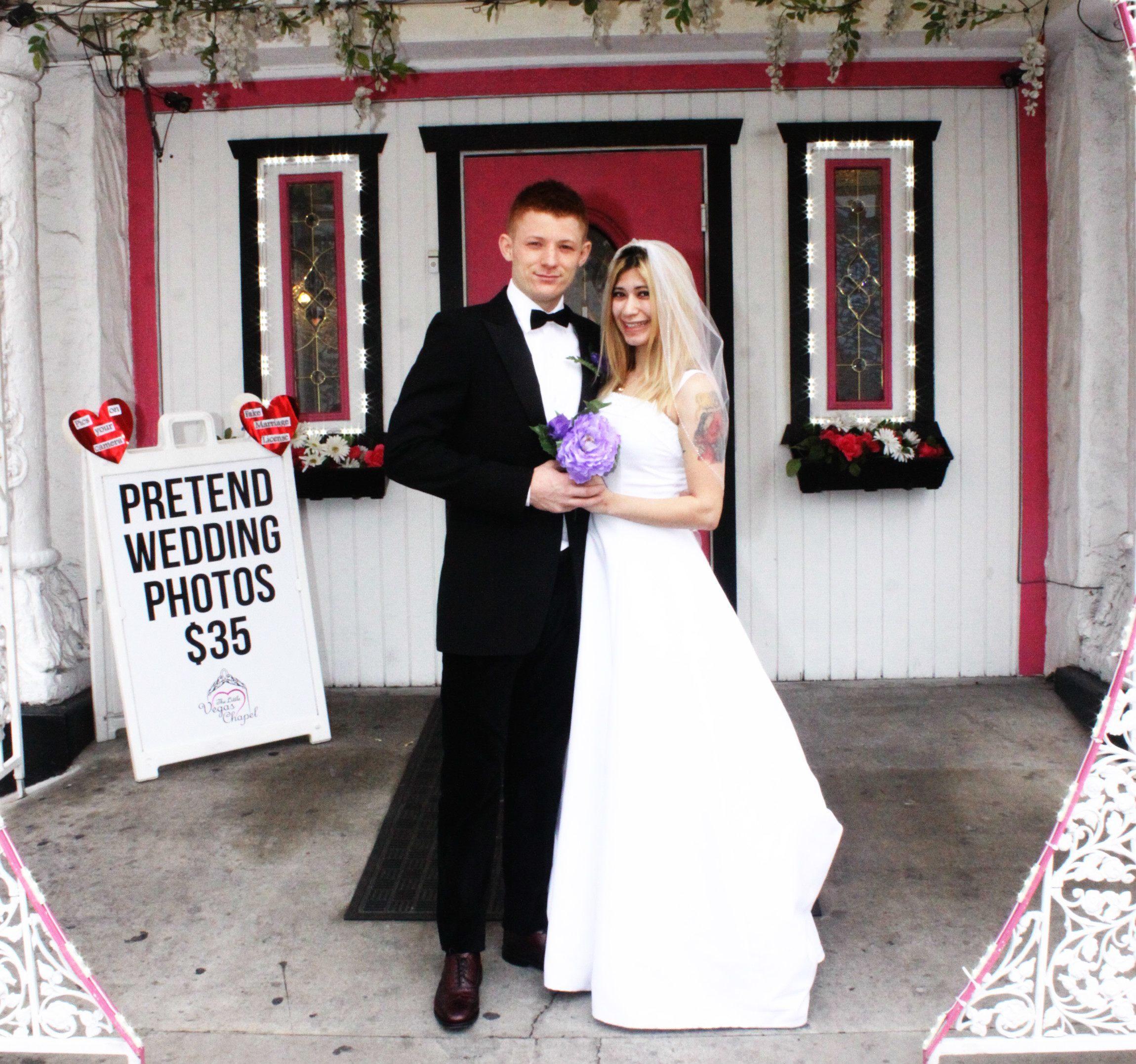 Bride and grrom pose for pretend wedding photos