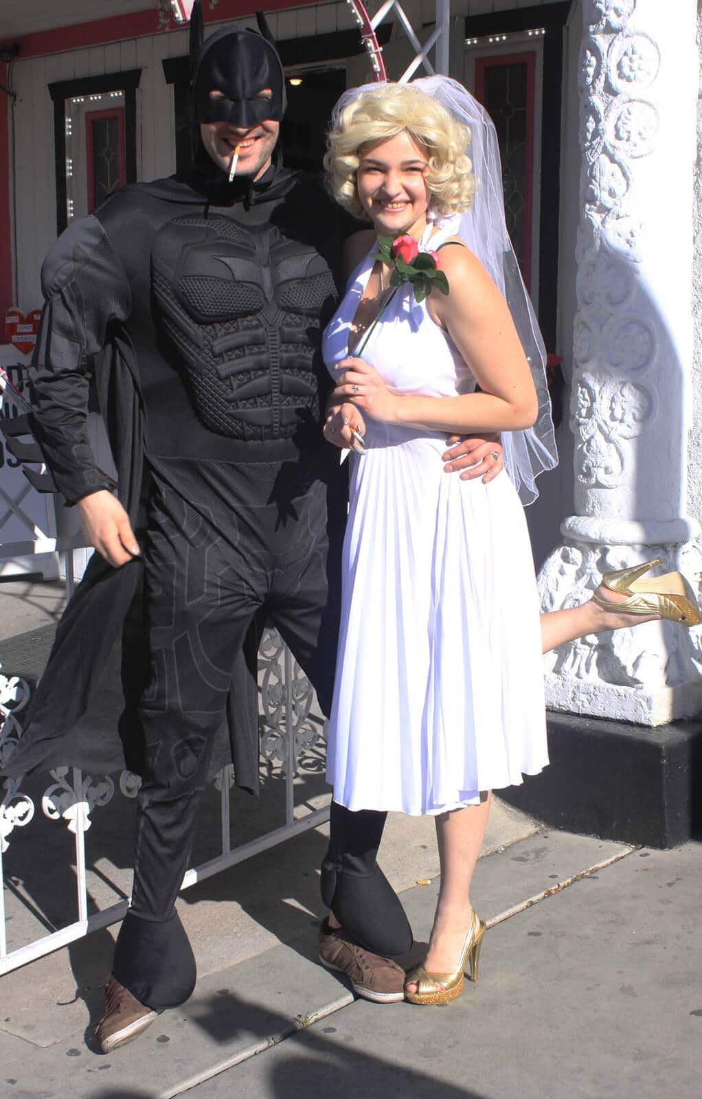 Bride and groom dressed as Batman and Marilyn Monroe