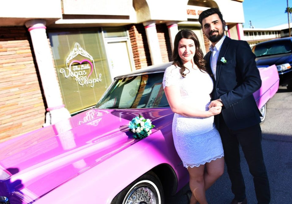 Newlywed couple and the Pink Limousine