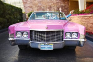 Elvis driving couple in pink Cadillac after wedding