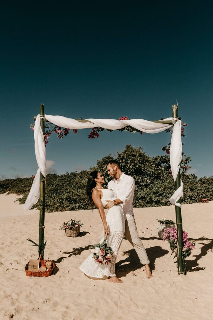 Newly Married Couple in White on the Beach